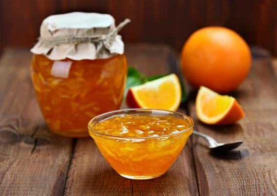 Orange jam on wooden table